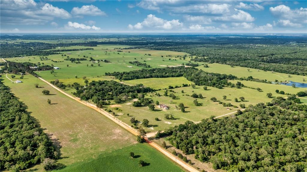 Just imagine what you could do with this 308 acres! From fishing and hunting, low taxes and a place to live or enjoy time off - this property has it all! Not only is the land amazing, but it comes with a great 4-bedroom, two bath, home that was built in 2017. You can escape all the noise and bustle while enjoying your view of the cows grazing on the rolling pasture. The ranch is composed of 2 ag-exempt tracts, and has 9 ponds stocked with bass. With Smith Creek passing through the back portion of the larger tract, an approximate 1-acre wetland on the south border is populated by bass, blue gill, and several species of ducks year round.  Approximately 40 acres along the creek are heavily wooded, providing lots of cover for game. The property has numerous hunting opportunities, including whitetail deer, ducks, hogs, and other native species. A large metal barn provides protection for tractors and equipment, as well as storage for hay and feed. And on top of all this, the sunsets and star gazing is unrivaled. Don't miss this property. It has it all...hunting, fishing, cattle, privacy, and room to roam.