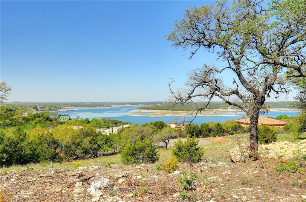 Rare opportunity to have an expansive lake Travis view in this custom modern ranch-style home. A true luxury residence awaits with fantastic Hill country and lake views from every room in the home. The home offers expansive indoor and outdoor living spaces which include 900 square feet of deck, an open sleeping porch, and 4 bedrooms with private bathrooms. The spacious guest quarters or secondary living area has its own private entrance and garage, along with a kitchenette, laundry room, and living room, all with access to an expansive porch overlooking all the exterior entertaining and ultimate pool area. The living area boasts 17 ft Barnwood ceilings, a floor-to-ceiling stone fireplace, travertine floors, and walls of glass with fantastic lake views. Enter the 40 ft wide travertine porch from the living room and enjoy the fantastic breezes and lake views. The gourmet kitchen is open to the great room and includes Thermador appliances, custom maple cabinets, and a spacious custom hickory island, perfect for entertaining. Adjacent to the kitchen is a wet bar, wine cellar, and a very large walk-in pantry with custom-built cabinets and drawers for all your storage needs. The floors are stunning 4-inch wide plank white oak wood and travertine flooring throughout. The 1200 sq ft master suite is situated with panoramic lake views, a luxurious bathroom with a large shower and soaker tub oversized his and her closets with custom built-ins. The views from the master bath are breathtaking!  The attention to detail in the construction process has been accomplished with superior oversite of the project by the Meticulous hands-on builder, overseeing every aspect of the build, every step of the way.  READY TO MOVE IN AT THE END OF OCTOBER!  Pool Video  https://youtu.be/_8kXybvRb-s