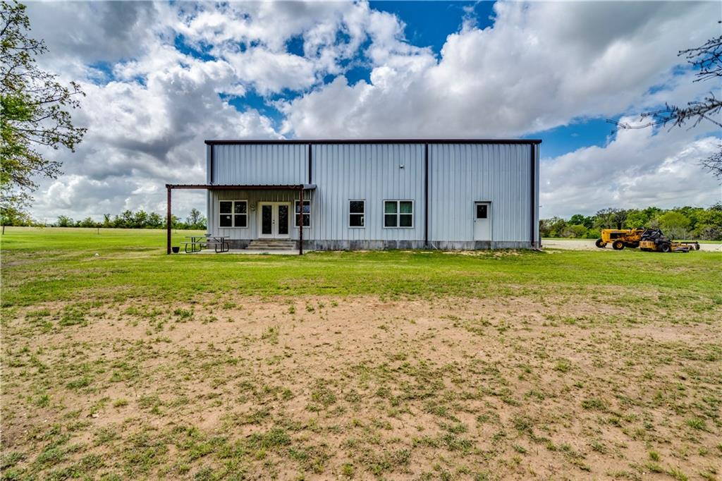 Get excited, here is an amazing opportunity to own a barndominium on your own slice of heaven. Great mixture of pasture and dense treed areas with 4 ponds hidden within (2 stocked with Florida Black Bass, Bluegill and hybrid minnow). Agriculture exemption already in place! The current home could be used as a full time workshop, guest home, hunting cabin or airbnb. Completely fenced with wire cross fencing. Well house and storage shed on property. Current water softener capable of servicing barndo and a site built home if you are looking to build. Great build sites everywhere with privacy on all sides and views of the ponds! The bedroom downstairs can easily be split into an additional bedroom or office making it 3 rooms. Shop is 1,275 SqFt with washer and dryer hookups. 900 SqFt covered parking attached to shop could be used for cars, RV, tractor or more. Two 14 ft rollup doors and one 6 ft rollup door built into the shop. Over 1,000 feet of frontage on post oak road. So peaceful and quiet, truly an unbelievable property.