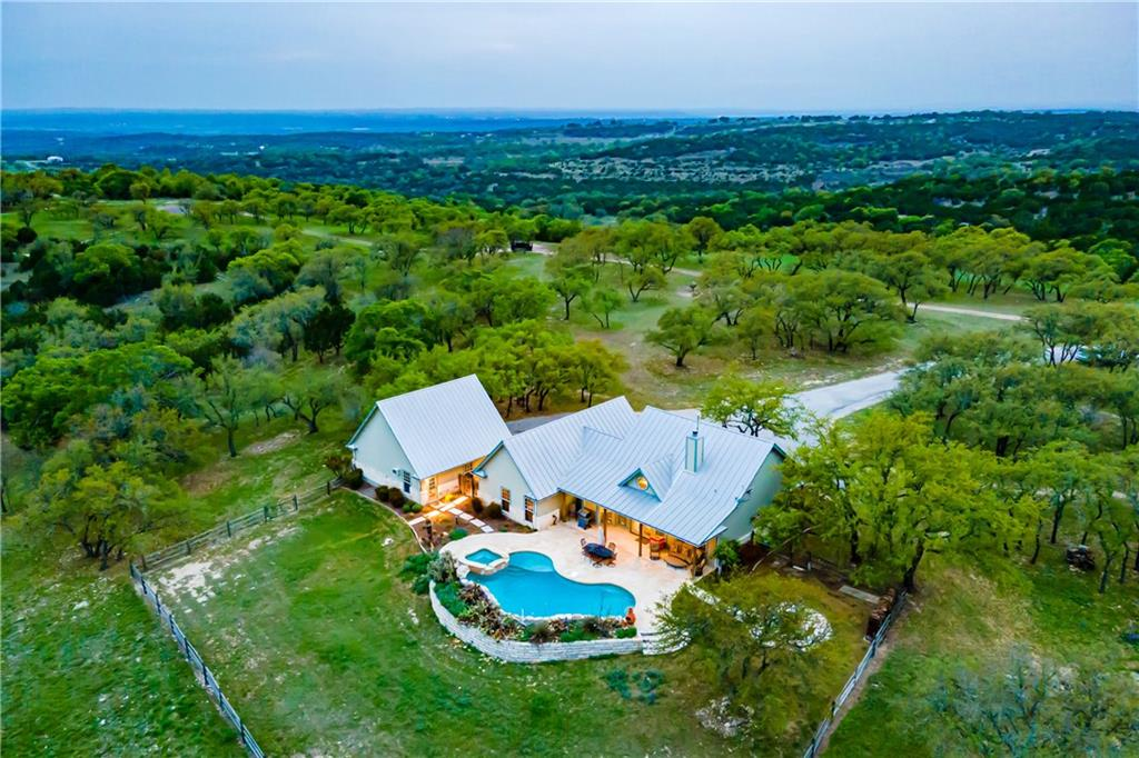 ~104-acre turnkey recreational ranch located just north and west of Austin and east of Marble Falls in the Ranches of Sycamore Falls Estates. Located in the rugged Balcones Canyonlands with dramatic long-range views and large elevation changes across the property. The ranch includes everything needed for a large family gathering place (sleeps up to 20 people) or a long-term private residence.  Includes a custom home, detached 3 car garage with storage and extra bedroom, guest house, large equipment storage building and workshop, swimming pool with spa and two stock ponds. This property is set up as the perfect getaway location and includes everything needed to immediately enjoy everything it has to offer. The property sale includes some furnishings in the house, guest house and garage apartment, deer feeders, fish feeder, hunting blinds, tripod stands, two Kubota tractors w/attachments and Kubota skid steer w/numerous attachments, two UTV's, two zero turn mowers and two utility trailers.  The current owners have done a fantastic job of updating, maintaining and improving the property. If you are looking for a well maintained, private, turnkey recreational ranch with long range views, lots of native wildlife and plenty of room to roam, you do not want to miss this opportunity.