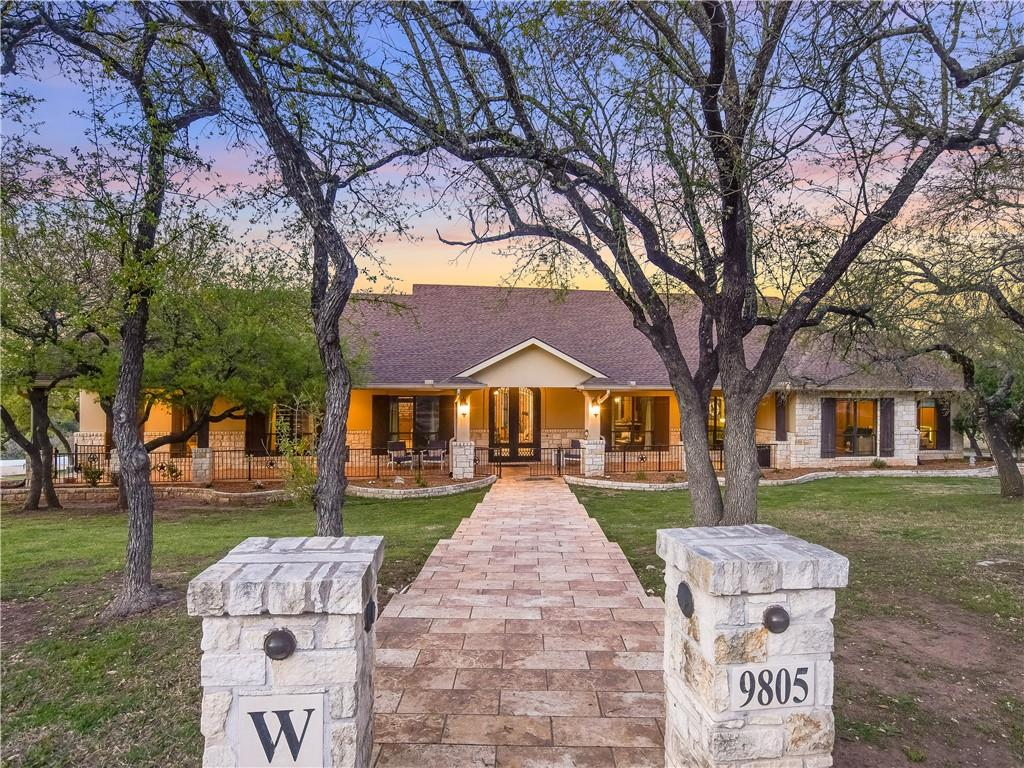 Stunning 16 acre estate located in the gated community of Ranches at Hamilton Pool.  Very Private yet only 12 miles from the Hill Country Galleria.  Well appointed home lives like a one story with master and three secondary bedrooms on main and fifth bedroom, full bath and game room up.  Wonderful outddor area with private pool & spa , sports court, batting cages and 2000 SF outbuilding used as gym.  Exemplary Rated Lake Travis Schools