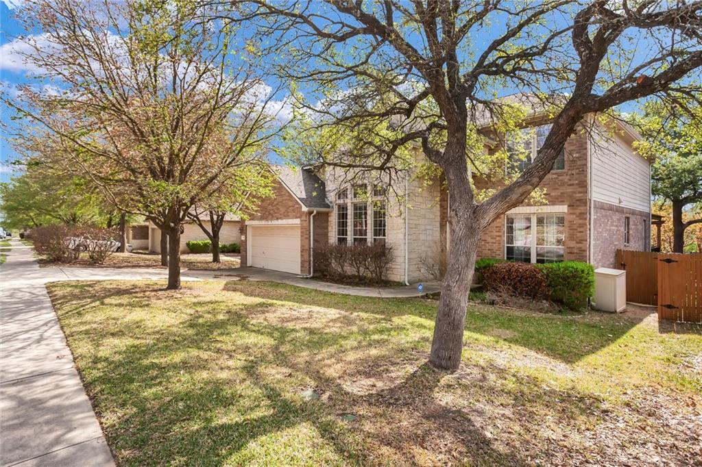 """Located between I-35 and 183A, this gorgeous home is only minutes from 2 HEBs, Costco, and the Outlet Mall, less than 25 miles from downtown Austin, and only 10 miles from downtown Georgetown.  There isn't a more convenient location North of Austin! Room for everyone is an understatement in this absolutely stunning home boasting 5 bedrooms and 3.5 bathrooms.  This home is an entertainer's dream. A spacious study, office, or flex room is at the front of the home across from the formal dining or sitting room.  The living room is situated around a beautiful gas fireplace with a limestone surround and is open to the kitchen. The large island invites your guests to sit and visit with the chef. The chef will love the stainless steel appliances, quartz countertops, and 42"""" cabinets. The floors in the common rooms of the home both upstairs and downstairs have been updated with gorgeous wood flooring. A half bath is located on the first floor for your guests.  The large master suite, with double sinks and a separate tub and shower in the bathroom, is located just off the living room. The four guest bedrooms are located upstairs along with a huge game room. Just when you thought this home couldn't be more perfect, there are TWO full bathrooms upstairs for your family or guests! The spacious backyard with its gorgeous mature oak trees and plenty of room to run and play, or just relax, also has a wood deck and exquisite pergola ready for your grill. And, if that wasn't enough, there is an extended concrete patio down the stairs from the wood deck perfect for a fire pit. If you'd like to cool off after spending time in the backyard, the community pool is just up the street and around the corner, along with a playground. The home is located in the highly sought-after Round Rock ISD. This home truly has it all! And, it has a new roof as of 5/7/2021."""