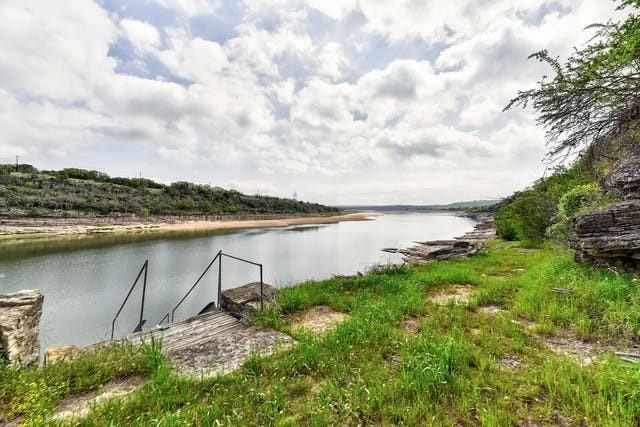 Where else can you fly in to your own private waterfront oasis on Lake Travis? Located in Spicewood.  Extremely rare find! ~400ft of lake frontage on over 8 acres in the Hill Country! This 4/3.5 newly remodeled home features an FAA runway as the driveway to the home with a 3000+ sq ft airplane hangar as a garage. Views from almost every room! Want space? This place has it all. Use the hangar, the pole barn, the greenhouse or even the storage shed. Looking for no neighbors and no restrictions? This place is pure peace on your own private lake front listing. Ag exemption in place allowing for extremely low taxes.  Welcome Home!