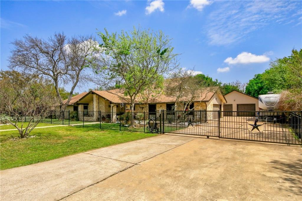 Minutes from I-35, IKEA and the Round Rock Outlet Mall!  This beautiful home sits on .659 of an acre with several entertaining areas.  Plenty of room to add a pool and garden.  1,500 sf workshop.  Gourmet kitchen with 2 additional refrigerator drawers in the island.  Electric gate and fully fenced yard.  Newly renovated master bath has a heated/jetted tub and walk in shower.  Large master closet and private courtyard.  Two story in-law suite with separate entrance, kitchenette, two bathrooms, small office and balcony.  Perfect for in-laws or the ultimate teen hangout.