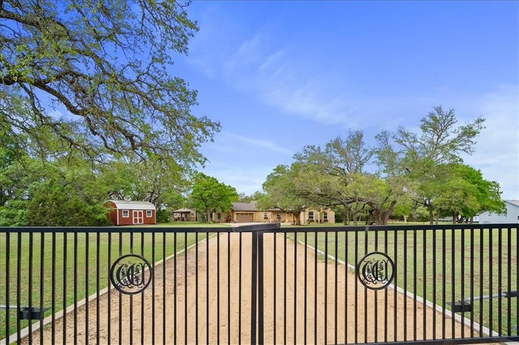 Charming executive retreat nestled on 3 acres just outside Burnet. Private, gated residence with a separate guest/office building or workshop. The home has upgraded features with seamless glass shower, sink in laundry, stained and scored concrete flooring, tray ceilings and an extended outdoor flagstone patio with fire pit. Serenity abounds in the natural setting of this TX country hideaway.