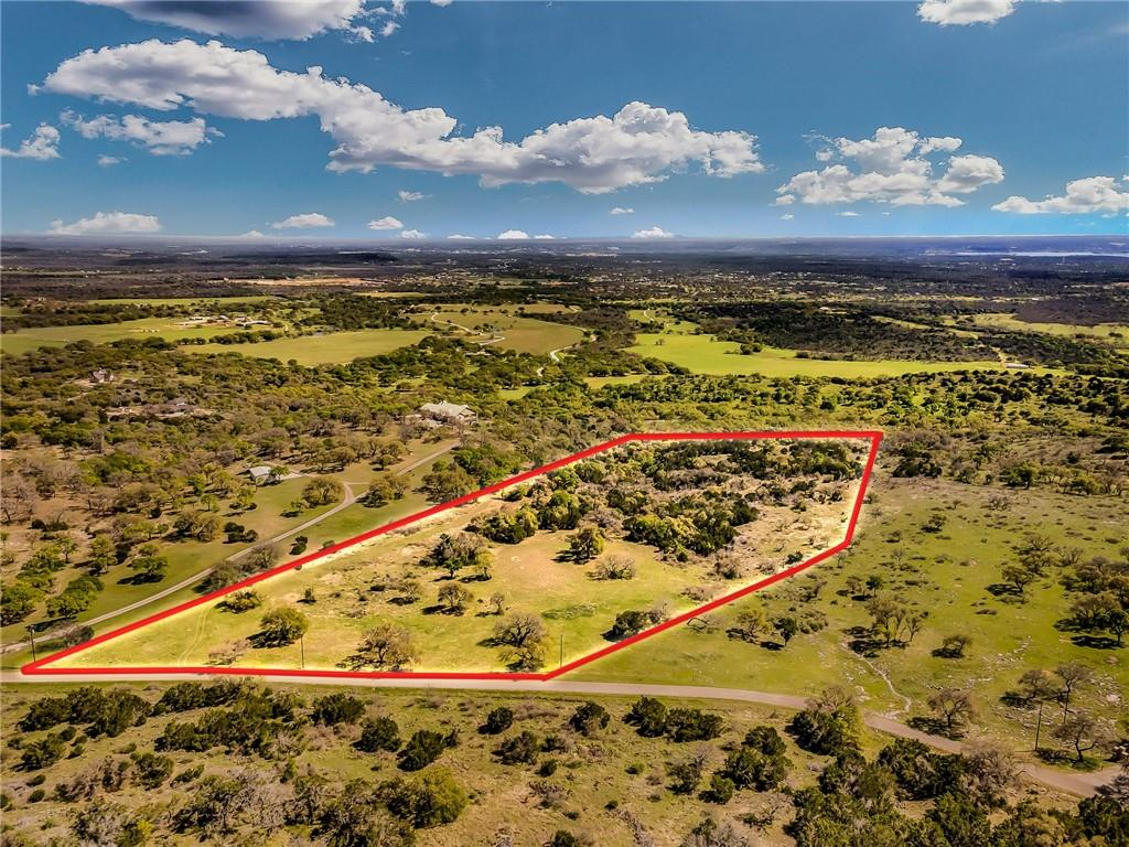 Spectacular Hill Country Views of Lake LBJ and River Valley. Property has 50 ft. Grotto Ravine. Multiple Excellent Building Sites!  10+Acreage Community surrounded by Million Dollar Homes. One of the few view tracts available in this area plus has UNOBSTRUCTED views for miles and miles! 3 sides fenced, large oak trees, MUST SEE, words do not do this land justice! Owner Financing. DO NOT walk property without owner-agent. Marble Falls ISD.