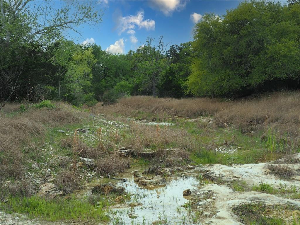 Approx. 77+ acres of recreational land just outside of La Grange on Hwy 71. Great weekend location for hunting with abundant wildlife, camping, ATV-ing, and exploring. The property features a rock bottom creek, rolling hills with great views at the back of the property, and a pond. Perfect for recreational or commercial use with easy access to Houston via I-10 and about an hour to Austin via Highway 71.