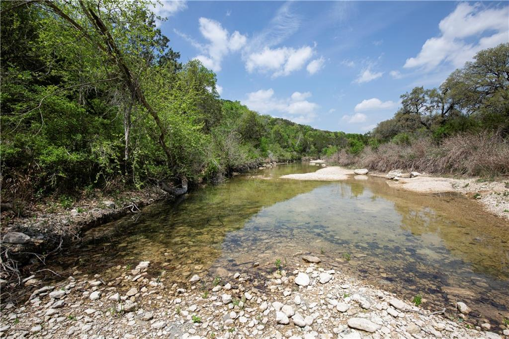 BEAUTIFUL & PRIVATE 50 ACRES OF BARTON CREEK FRONTAGE. The property is located at the end of Silver Creek Road just off of Fitzhugh Road and east of RR12 intersection is available for subdivision. Grand Oaks throughout this multi-elevation acreage. Outstanding views with park-like creek frontage progressing to high cliff acmes. Located in Dripping Springs ETJ and moments from Bee Cave, Lakeway, and Austin. This unrestricted 50 Acres is available for subdivision and adjoins a large ranch across Barton Creek. The tract is being surveyed out of 91 acres with the present owner retaining the remaining acreage and home. Recreational activities exploring creek features and hunting. Current tax ag use valuation. Future owners will be able to watch unobstructed Texas sunrises and sunsets while also being close to bakeries, restaurants, and doggy day cares.  The Solano Estate Winery and Jester King Brewery are also nearby providing close entertainment opportunities.  Bring your horses, build a home and barn or subdivide the property.