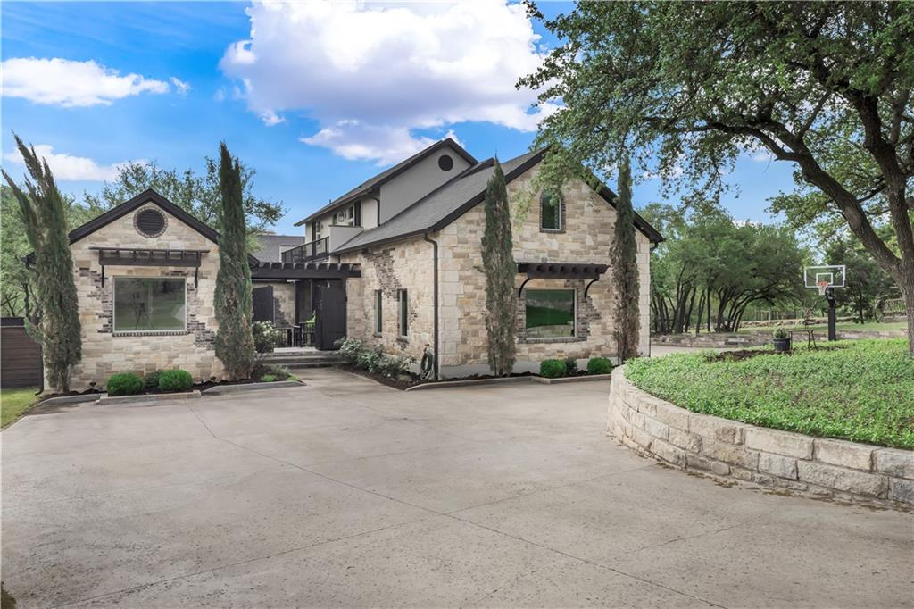 """Incredible find ~ one of a kind!  Custom designed and built, amazing home located on 3.16 acres with 400 feet of Bee Creek frontage, heated & cooled pool, guest casita with full bath, bonus room, 3 car garage, 3700 sq ft party barn, elevated """"crow's nest"""" deck, tree house, zip line, tree swing, fire pit, washer pit, storage shed, private courtyard, several outdoor entertaining spaces and so much more!  The huge master closet doubles as a safe room, made to withstand a category 4 tornado.  This home also features a 600 foot well, 7 stage water filtration & RO system with insta-hot tankless water heater, back up generator, underground propane tank, huge oak trees, tons of wild life and privacy.  Growing area, Lake Travis schools, minutes from Hill Country Galleria & 35 minutes to downtown Austin, less than an hour to the ABIA airport."""