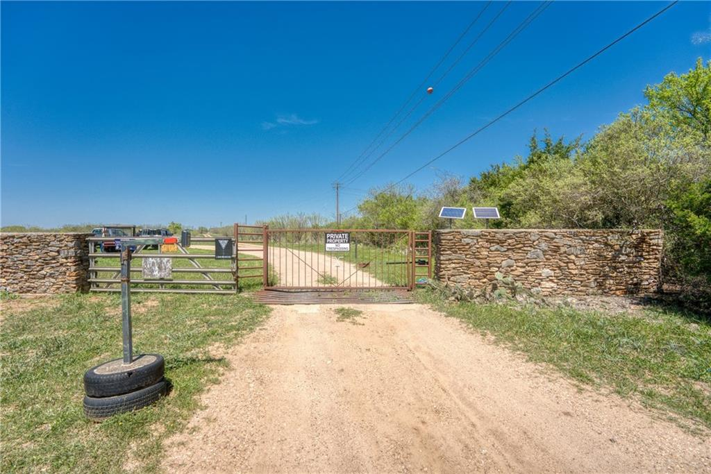 This pristine land is easily traversed by ranch roads the hills and creeks.  Improvements include water well, cross fences, corrals and a grass landing strip. The back (western) boundary adjoins LCRA land and has a 142 acre conservation easement.  Buyer's agent must be identified on first contact and must accompany buyer on first showing