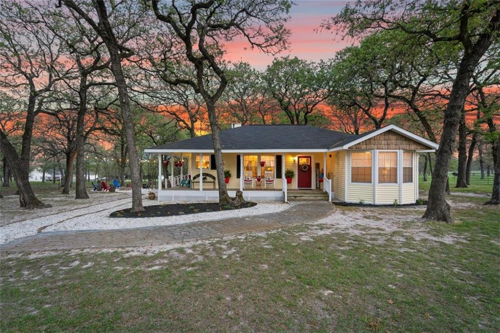 WITHIN AN HOUR TO AUSTIN, 45 MINUTES TO ROUND ROCK, 25 MINUTES TO TAYLOR! A lovely jewel in Milam county! Country living at it's best and yet just outside of town! Escape the rat race to this lovely updated country home with a delightful wrap around porch nestled among numerous mature oaks sitting on 20 beautiful, partially open, pasture with areas of coastal grass on sandy loam, horse friendly, acres. Suitable for a multitude of options. Features a metal barn, 30' x 60', with 4 Priefert stalls, enclosed tack/feed room on concrete floor, electricity and a hay storage area. Also a 13' x 13' storage building of vinyl siding with metal roof, and a detached 20' x 20' - 2 car garage on slab with metal roof with a 20' x 10' storage area attached. Imagine sitting on the covered back porch or wrap around porch overlooking your property or relaxing by the firepit enjoying your favorite beverage with friends and family! There are approx. 15 fenced acres in back pasture with scattered trees.