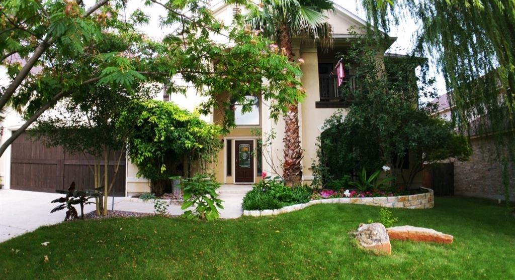Amazing home with large trees, attractive white stone-lined flower beds, and lush landscaping. This home has the curb appeal that you are looking for! An impressive entry leads to a stunning foyer with 2 story ceilings and beautiful travertine floors. The formal dining room and formal living room, which are on opposite sides of the foyer, also have travertine floors, plantation shutters and crown molding. Just past the formal dining is the bamboo wood staircase leading to the upper level which is also bamboo throughout. Continuing through the archway is the family room with a wall of windows, overlooking the gorgeous backyard and Koi pond. The family room, kitchen and breakfast nook flow seamlessly and are conducive to entertaining many guests. The resident chef will enjoy the spacious newly remodeled kitchen with a double oven, a huge island and plenty of counter and storage space. The guest bath and the laundry room are located just past the kitchen. The Owner's Retreat, on the main level, has 2 large walk-in closets, a large bathroom with jetted garden tub and a staircase that leads to an additional room that can be used as a study, office or gym. Upstairs you will find the game room/loft/media room that provides a lot of space for games/entertainment and is wired for surround sound, 4 additional bedrooms with upgraded carpet, plus a Jack and Jill bathroom. Across the hall there is another full bathroom adjacent a bedroom. There are also two attics for lots of storage space. Outdoors there is a covered patio large enough to have BBQs with family and friends. The large trees and the sound of the waterfall in the pond create a resort-like feel. Once night falls you will enjoy the up-lighting that makes trees in the front and back light up. The house is fully fitted with rain gutters, has rain collection barrels, as custom built shed and a dog run on the side of the house.