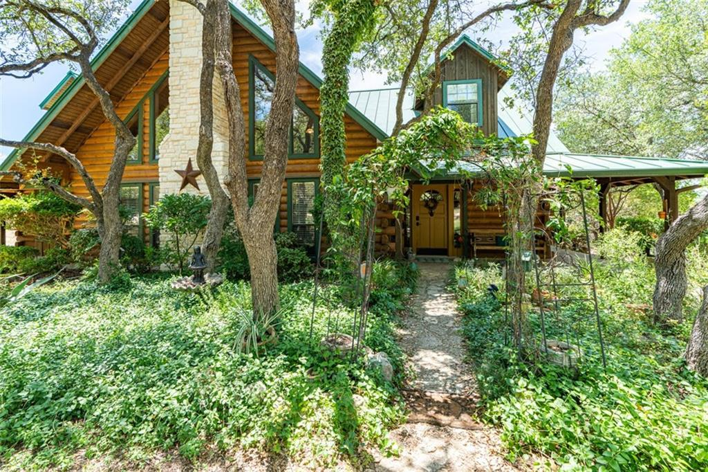 This is your opportunity to purchase this unique custom property with 10.74 acres, 3702 sq. ft. log home and currently a Pet Boarding Facility which could be converted easily into horse stalls, a garage, a casita, endless possibilities.  AWESOME sunsets with wrap around porch and rolling hills with no rooftops in sight!!!  10 minutes from Pedernales State Park  3 BDM (could be converted to up to 5 BDM) game room,  3 BATHS, several decks and wrought iron railings.  Rustic Elegance at it's finest, horses allowed.  $15K Decorating allowance