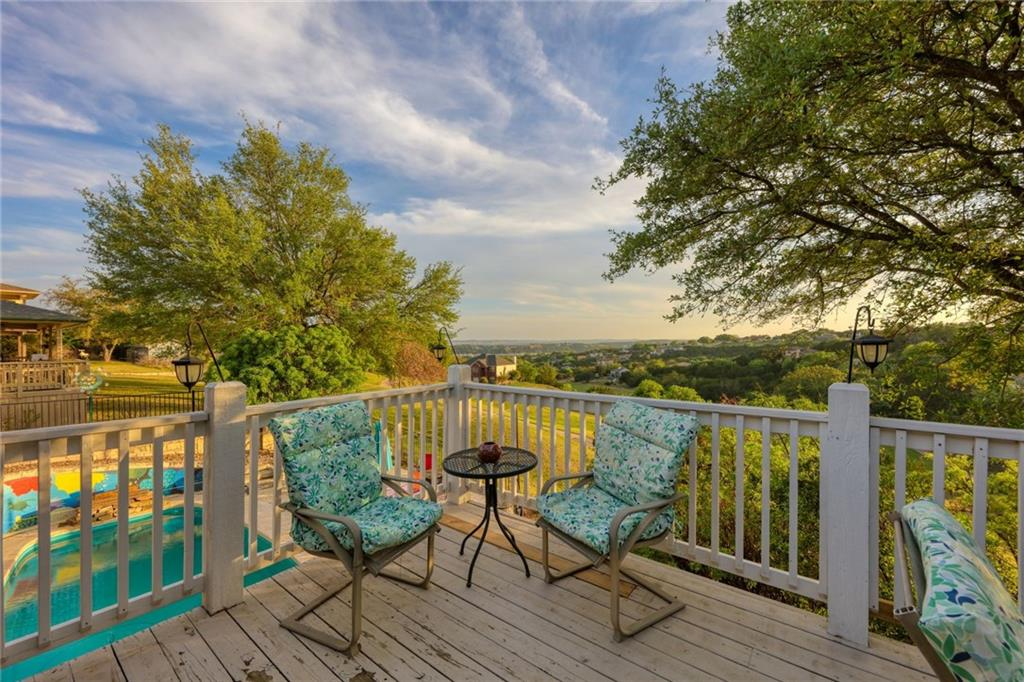 Unique property in the Beautiful Texas Hill Country, Majestic panoramic views of Lake Travis, sits right on the golf course, with your own private Salt Water Swimming Pool. Currently a income producing 5 star Air B&B, or, your own private vacation spot. This property has to be seen to believed! H VAC, Grinder Pump, Roof and Gutters all new as of 4/2021. Hurry this one will not last! Ready for move in! Part owner in 10 Waterfront Parks, Workout Center, Meeting Rooms, Tennis Courts, Swimming Pool and much more.