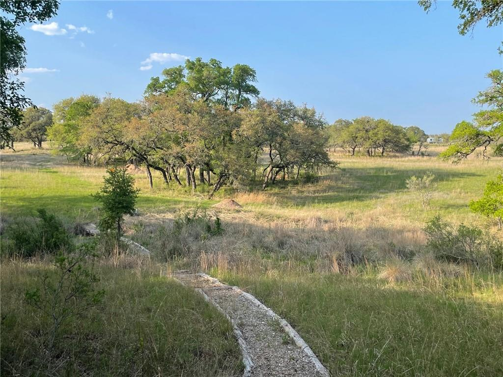 Great opportunity to own a beautiful 45 acre ranch 2 miles from the heart of Wimberley and centrally located between Austin and San Antonio. This property is a great mix of large trees and native pasture that has been cleared of cedar.  The biodiversity of this property is amazing with an incredible mixture of native grasses, wild flowers and a great variety of trees. There are several build sites with long distance views, a perfect location for a pond at the head of Wilson Creek and a hiking trail through the towering trees. This property is part of the Heaton Hollow subdivision and has perimeter high fence and has a Wildlife exemption. With the gently sloping ground and native grass pasture this would be a great horse property.