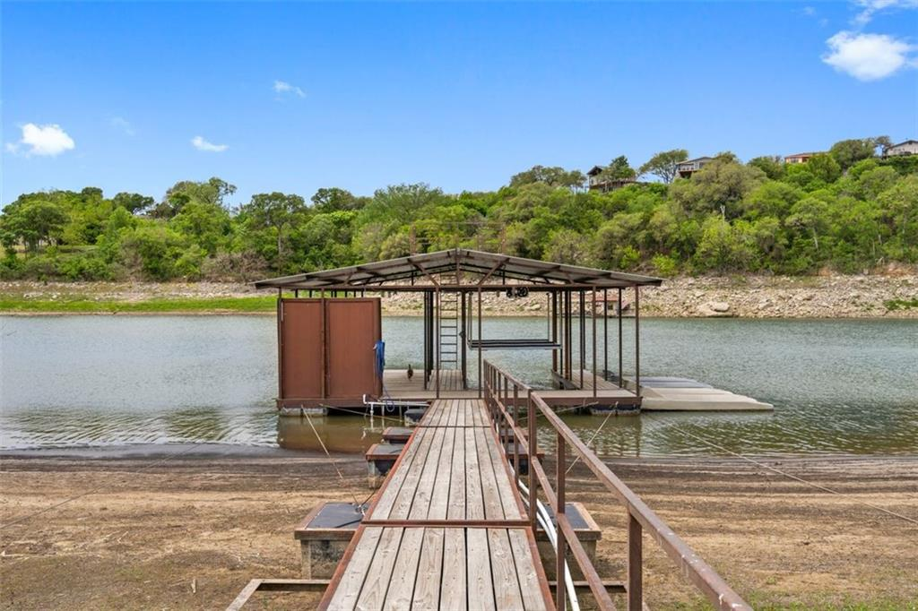 Your dream Lake Travis Lake house. 4 level lakefront home, 6bed, 4.5 baths. Party dock, with electric boat lift, also your own boat ramp. Plus a 2400 sqft metal barn for any additional lake toys you have. Perfect forever home or investment property.
