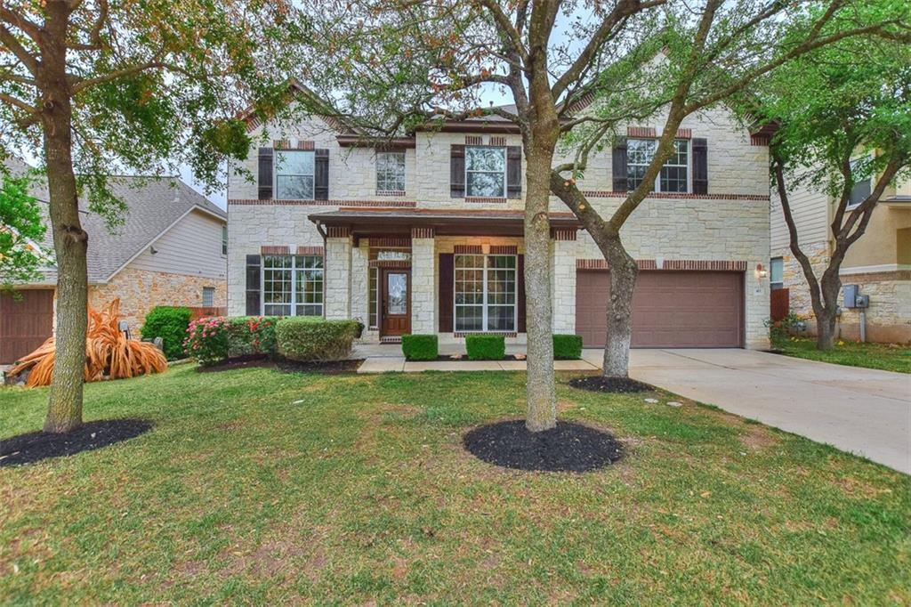 Freshly painted and move-in ready! The first floor offers a large family room with soaring ceilings and an inviting fireplace! A guest suite which can also function as an office is also located on the first floor.  The large sun room allows natural light to spill inside the house and bathe the area with natural light.  The kitchen cabinets are a natural wood tone and are complimented by the granite counters.  Upstairs, you'll find a large game room, the owner's suite with two walk-in closets.  Three additional bedrooms are on the second floor! The back yard is private, has fruit trees and backs to green space! There is an additional 1/2 car sized bay in the garage with built in storage, hanging from the ceiling!