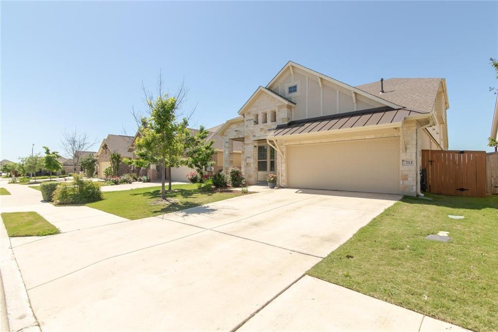 GORGEOUS 2 story home, in the sought after Teravista Community in Georgetown! You are greeted with a lovely covered front patio before stepping into a BEAUTIFUL front entryway, with HIGH ceilings and tile flooring which, flows throughout most of the main floor. To your left will be a bedroom with a walk in closet and a bathroom with tub/shower combo just steps away. Across the other side of the entryway is a LARGE walk in laundry room with a custom built-in MUD ROOM bench for additional storage. You will continue under an archway and enter into an OPEN living space with full dining area to your left and a Kitchen fit for a Chef to your right. This would be perfect for a family who loves to entertain! The kitchen comes complete with Stainless Steel appliances, Granite countertops, and PLENTY of counter and storage space. A HUGE Island, which can seat up to 5 people is just what you need for those large family gatherings! As you enter your SPACIOUS owners suite on the main level, you will see nice tray ceiling with ceiling fan and plenty of natural sunlight! This suite comes complete with an OPEN bathroom with separate vanities, a large walk in closet, relaxing garden tub and a separate shower. As you make your way upstairs, you step into a second living space perfect for a GAME ROOM/PLAY ROOM. It has plenty of sunlight with a nice window ledge adding some design to the space. Down the hallway is the additional 2 bedrooms, both with walk in closets, one of which has a door to walk into the ATTIC with additional storage space! A full bath/shower combo with single vanity is just steps away! Enjoy relaxing in your beautiful backyard with a LARGE covered back porch perfect for the Texas BBQ's and great OPEN yard for a trampoline, playscape or pool! Come see the absolutely GORGEOUS home, it will not last long!