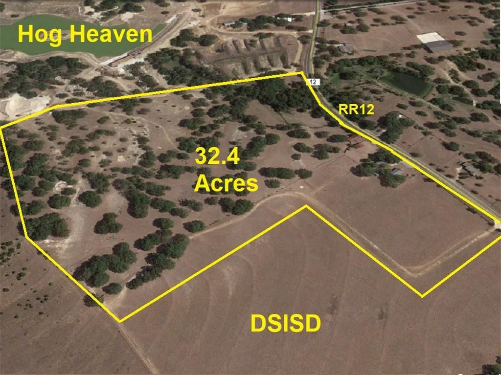 This subdividable, ag exempt, almost completely unrestricted 32.4 acre tract is a developer's dream because it has 1,150 ft of RR12 frontage, no FEMA flood plain, acres of flat building sites with east facing views, magnificent oak trees that would make a state park envious, and located just minutes from booming Dripping Springs. But water is what sets it apart from other commercial tracts.  When the DSISD school is constructed there is a possibility of securing public water from the DSWSC wells across the street, which could double or triple the allowed density. Buyer to verify. The area has other prodigious wells, like the prolific ones that fill the neighbor's artificial lakes. The seasonal creek can be dammed to make a spectacular pond. Shown by appointment only.  Please do not disturb tenants, farmers or guard dogs. Selling at land value only.