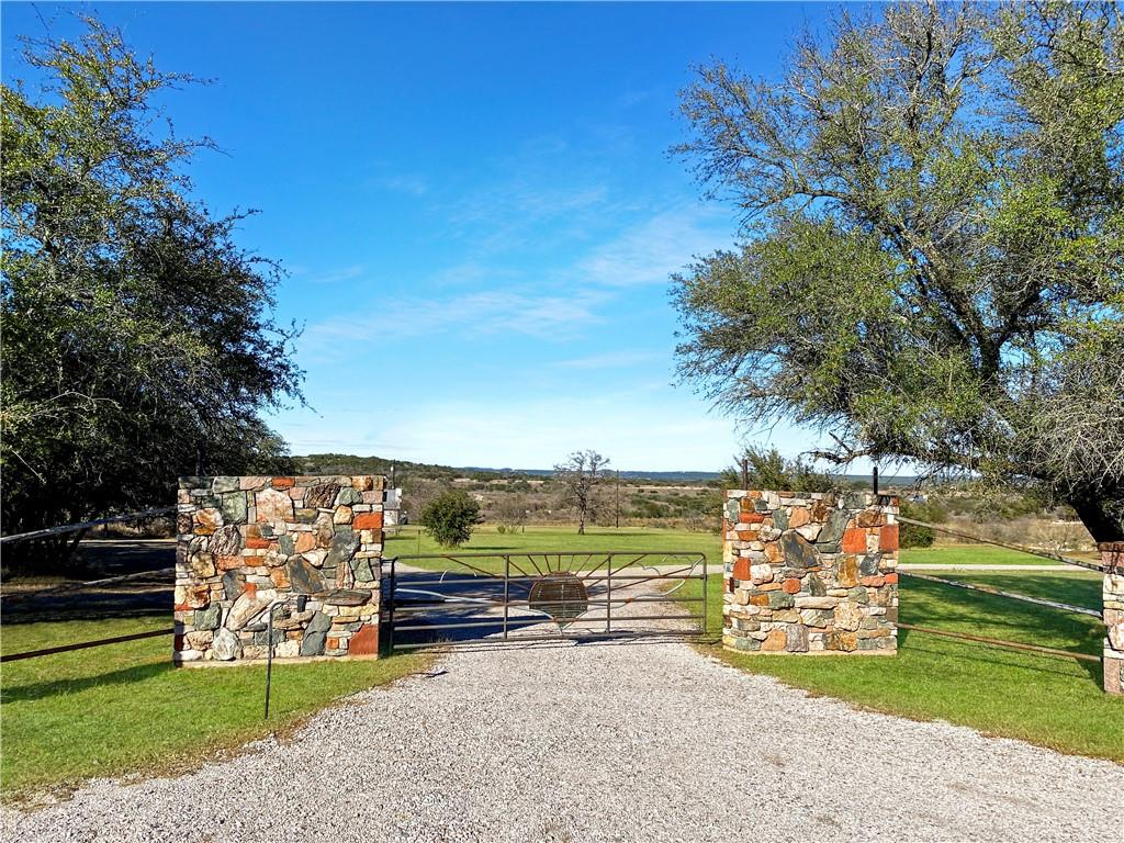 Welcome to BIG Texas sky views, deep in the heart of Texas.  Want to get out of the city and live on 15 quiet acres?  Peace and serenity awaits you here!   This picturesque 15 acreage in sleepy Spicewood captivates the perfect place for you to relax.   Horses welcome!  Situated near a little cove of the Pedernales (near the convergence with Lake Travis), this property displays dramatic scenery with sweeping landscapes of huge, panoramic hill country views!  Lots of space to build your dream home!   Deed restrictions provide the ability to SUBDIVIDE this residential property.  NO HOA!!   Some of the coolest unique rock formations on the bluff heading to the cove.   Several open air sheds on this property.  A bonus is the rustic outdoor kitchen!  Only 20 minutes to the Galleria, Whole Foods, Home Depot, HEB, shopping.   Showings are by appointment only.  **Seller requires Proof of Fund and must call Listing Agent to schedule appointment.**