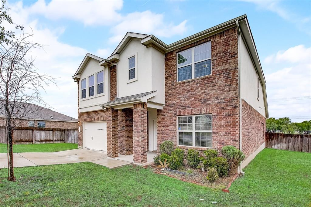 Built in 2017, this Leander two-story cul-de-sac home offers a patio, granite countertops, and a two-car garage.
