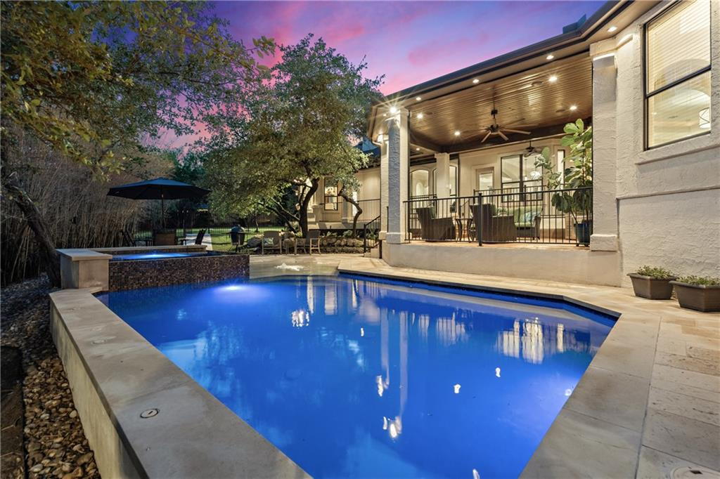 A rare find in the popular and coveted Lakeway area - stunning custom dream home on a quiet cul-de-sac lot in the heart of Lakeway! This updated one-story home with a pool and a bonus media/theater room and exercise room on the second level is an entertainer's delight! You will love the bright open floor plan that flows seamlessly through the living room, kitchen and dining area. Abundant natural light bounces through the spacious layout across pristine wall of windows, scored concrete floors and soaring ceilings. The beautifully appointed and well-maintained interior features generously-sized rooms, boxed ceilings, neutral paint colors, double crown, custom cabinetry and so much more. The kitchen is a Chef's dream featuring stainlesss steel appliances, quartzite countertops and a handy breakfast nook - all overlooking the inviting family room. Complete with a private sitting area and spa-like double-vanity bath with large walk-in closet, the secluded master suite is truly an owner's retreat. Boasting 5 bedrooms, 4.5 baths, multiple living and dining areas, and a private backyard oasis with large covered patio and sparkling pool with spa, this fabulous home is set up for easy day-to-day living and makes grand scale entertaining a delight! Within walking distance to Hamilton Greenbelt, Cafe Lago and Lakeway Activity Center. Close proximity to Lakeway City Park, marinas, paddle boarding, parks and hiking trails. Take advantage of the highly-rated schools within the acclaimed Lake Travis ISD. See for yourself what this home has to offer. Visit http://bit.ly/106Galaxy3D for a 3D virtual walkthrough.