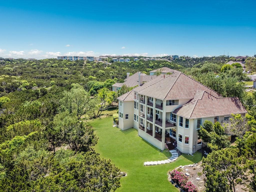 Fall in love with this incredible home located in a serene gated community of 21 homes in the heart of Lakeway minutes away from Lake Travis.  This house is a full 3-level gem which sits on a manicured 1 plus acre lot with mature trees which includes plenty of room for a pool.  Spectacular breathtaking views from 3 balconies overlooking a protected greenbelt.  Walking distance away from pharmacy/grocery, 2 minute drive to a leading Hospital, Lake Travis High School and Lakeway Elementary. Bespoke custom kitchen with wolf/subzero appliances.  This house includes an over 500 bottle custom walk-in wine room, 7 seat theater room with surround sound, personal home gym, 2 private offices and room for au pair or for extended family to live.