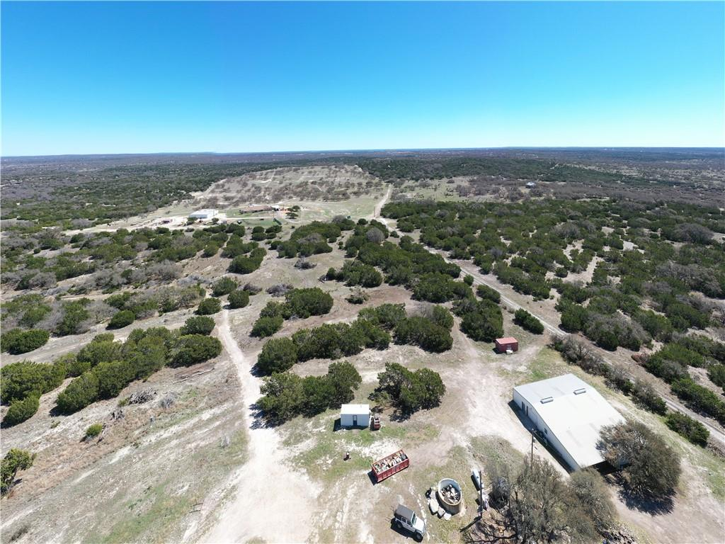 This beautiful property is located just 45 minutes west of Fredericksburg and 45 minutes from Kerrville. Tucked away 20 minutes outside of Harper located in both Gillespie and Kimble counties. This is the ultimate Gentleman's ranch or Homestead to get away from it all. The 186 acres gives you plenty of room to do what you want. The land is a mix of rolling hills, creek bottoms, and flat areas with large oaks and some cedar trees. The main house is situated at the highest point on the property offering panoramic views of the hill county. The sunsets from the back porch are one of a kind! The main house is 2404 sqft 3/3.5 built in 2005. The house is an open living and kitchen concept with a large rock fireplace in the living room. Solar panels keeps the electric bill under $60 a month even during the summer months. The water well pump was just replaced after the week long freeze. There is also a 2500 gallon water storage tank. Down from the house is a 40x60 2400 sqft shop with roll up doors on either end. The shop has water and electric with an air conditioned office and a full bathroom attached. A drain in the middle of the shop with a winch makes it a perfect place to clean game from the ranch. Off of the shop is a large covered area perfect for parking ranch toys and equipment. There is also a 1 bedroom cabin located on the property with separate electrical, septic, and a water well. There is a separate entrance through an easement to the back half of the property where the cabin is located that could be separated if desired. There is plenty of game on the ranch including Whitetail deer, hogs, and turkey. There are 5 blinds around the ranch with feeders. A network of roads gets you to any part of the ranch you want. Enjoy low taxes with a wildlife exemption all ready in place.  This ranch has it all. Take a closer look of the land with the link of the drone footage.