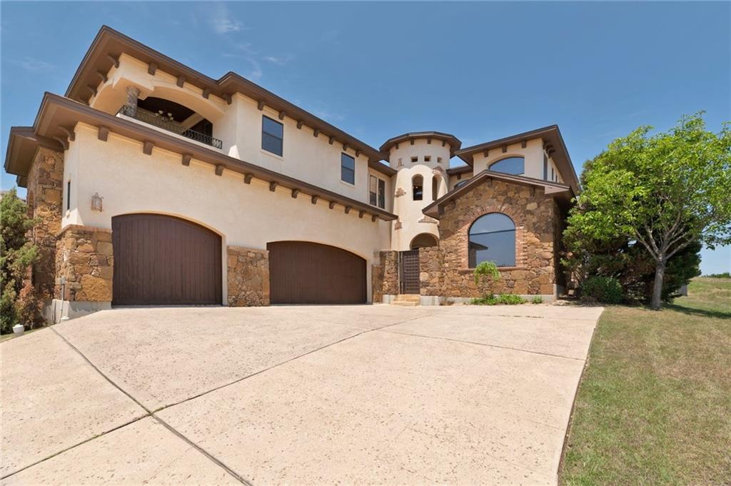 Former home of owner of Masters Touch Custom Homes. This home boasts numerous custom features such as a gated courtyard with Cantera door and beautiful fountain, double Cantera door entry into home, two-story brick and stone fireplace, unique bathroom with stone wall and custom water feature, soaring ceilings, all floors hardwood or stone, solid alder wood doors in all rooms, chef's kitchen with gas range, game room with wet bar, and upstairs deck with hill country views of the Balcones Preserve and beyond. Enjoy surround sound entertainment while cozying up to the fireplace in the two-story living room.  Conveniently located to all services, Oaks of Lakeway, Hill Country Galleria and a multitude of restaurants and shopping nearby, and yet the hill country is within reach. This is a quality home that is evidenced by the low electric bills. One of the rare homes with NO HOA FEES, YET ALL THE BENEFITS!