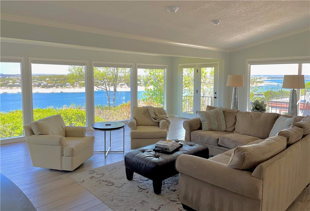 Views, Views, Views.  This updated home sited on a bluff overlooking Lake Travis features breathtaking panoramic lake views, an open kitchen, tile floors, rear and rooftop decks, walk-in closets, laundry room, and private workspace.   Visit 721Mariner.com to learn more.