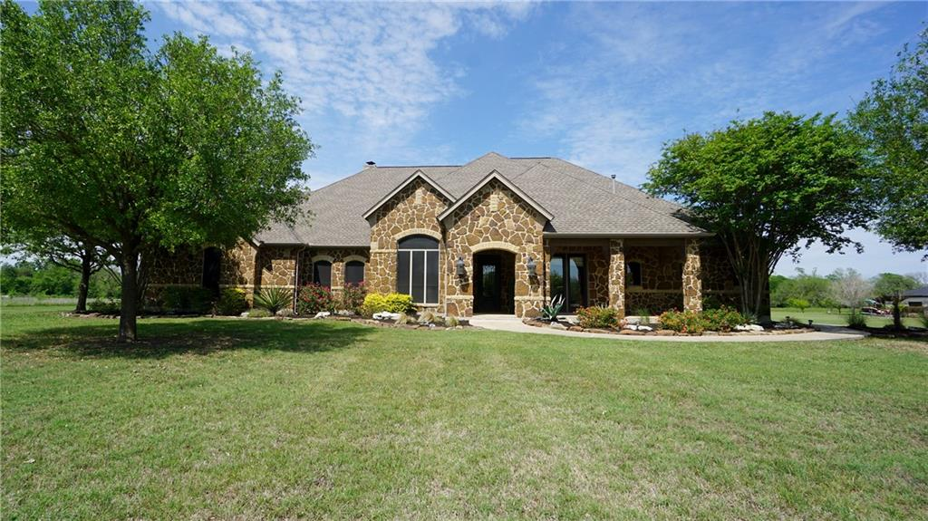 STUNNING backyard oasis is just one of many spectacular features of this beautiful custom built home! Almost 8 acres (2 horses allowed), backing to tree shaded Brushy Creek, fantastic outdoor kitchen: grill, cooktop, sink, refrigerator, ice maker,& granite counters, all overlooking a beautiful newly refinished Caribbean-blue pool w/waterfall. Inside you'll find a totally remodeled home. True chef's kitchen with professional grade range/double oven, copper sinks, butler pantry, & beautiful granite counters, hand scrapped hardwood floors, hand chipped travertine throughout, custom Primitives canceliers, Cantera wrought iron front door, huge game room  and Epoxy garage flooring.