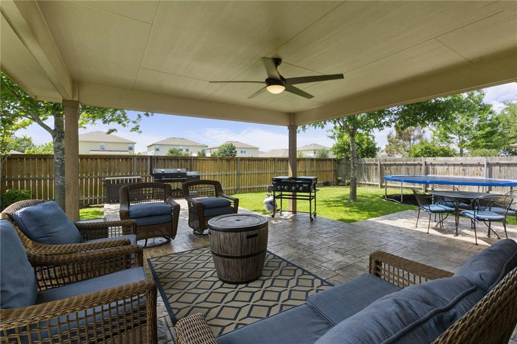 Amazing outdoor living space made for entertaining guests and perfect for family B-B-Q's, sitting area/bbq area/kids play area this back yard has it all, solar panels, 21x16 extended covered back porch with ceiling fan & light dimmer, 19x21 extended uncovered patio, thicker 10x10 slab for future hot tub, 17x4 slab on side for future storage, attention to detail at its finest, very open floor plan, kitchen open to & overlooks family room, kitchen features dining area/kitchen island and added cabinets w/ soft close hinges & black stainless steel appliances, spacious family room, wood-like tile flooring throughout entire house, no carpet/less allergies, pop up ceiling in master bedroom, custom cabinets & shelving in master closet, separate tub & shower, dual vanity, sprinkler system, security cameras w/ dvr, no neighbors behind house, must see this amazing house