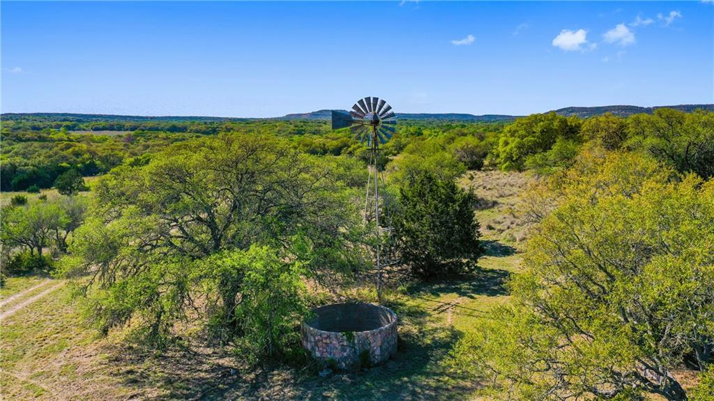 The Red Corral Ranch is Approx. 632 Acres about 11 Miles from Downtown Wimberley, TX.  The ranchland is a good mix consisting of several great hilltops that offer amazing hill country views, and the ranch also offers several open fields.  The hard wood trees on this ranch are absolutely stunning and abundant.  The access to the ranch is amazing and offers approx. 3500 ft. of frontage on paved Red Corral Ranch Rd.  There are 5 water wells on the ranch, 3 are windmills and 2 are submersible pumps.  Wanslow Creek traverses the property and is seasonal. There are 3 modest homes on the ranch.  All 3 are in livable condition and have been currently used as rentals.  There is a good road thru the ranch that is easily traveled by truck or ATV.  The property is High Fenced on 3 sides and will need a new fence on the new boundary.  Electricity is on the ranch.  This is a fantastic ranch located in one of the fastest growing areas in the USA. The ranch is currently under a wildlife exemption   Located minutes from Wimberly and Blanco, and less than an hour to Austin and San Antonio.