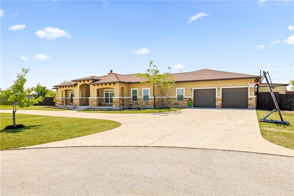 Located in the coveted Green Haven Ranch subdivision on 1 acre, cul de sac. Spacious custom home designed for entertaining with an awesome open floor plan; 10-13 foot tall ceilings throughout; stone fireplace with gas logs; custom barn doors; wet-bar w/ice-maker, dry-bar with wine/bev fridge; relaxing owners retreat with luxury spa bath, enormous walk in shower, double shower heads; soaking tub; his/her closets; large linen closet; huge laundry/craft/mudroom; 2 bedrooms with Jack-n-Jill bath; office with closet, could function as 4th bedroom. Custom cabinetry throughout; granite countertops in kitchen, custom marble countertops in bathrooms. Massive backyard with huge covered patio, pool/hot tub with waterfall feature; deluxe redwood playscape for the kids.  Large equipment/tool storage shed.  1000 sq foot, 4 car garage with ample overhead storage. Spray foam insulation throughout home; automatic attic exhaust fan helps keep the home cool in the Texas heat; low energy bills. 5 minutes from Dell Diamond baseball stadium and Kalahari indoor waterpark; 30 minutes from the new Tesla Gigafactory, Apple Austin campus, & downtown Austin.  Walking distance to the brand new elementary school.   See offer instructions.