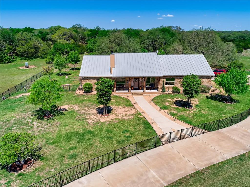 "This immaculately presented home is set amongst a beautiful manicured yard within a private park-like backyard, Gated Community with 21.918 Acres ~ Property has a Wildlife Tax Exemption~ This home comes complete with a chef style kitchen including recent stainless appliances, granite countertops, incredible mesquite wood breakfast bar top nicely surrounds the kitchen area and seats 6 people comfortably; Elegant separate dining area, gas stove top,  custom knotty alder cabinets;  The kitchen is open to the family room and second dining area;   Beautiful finish work including knotty alder interior doors as well as a  barn style door into the office; Incredible Master suite with private door out to the patio and a glamorous master closet designed by California Closets-you will love the extra lighting; Master bath includes a stone walk through shower and his/her split vanities; Garage is a ""gentleman's dream"" includes epoxy flooring, stainless cabinets and Rubbermaid rail system; Entertain in grand style as you relax around the pool and enjoy the outdoor kitchen~Sellers have spared nothing~ This home comes with Generac Whole Home Generator, Full sprinkler system, Two Tankless Water Heater, Generac Standby Generator, 2020 Ruud AC, Iron Fencing around the house perimeters, Recent fixtures, recent landscaping, Recent stonework, Honeywell Security System, Wifi Video Surveillance system;  Well is approx. 1000 ft, 3000 gallons  and the pump is a high end on demand variable speed 2.5hp; Iron fencing around the main perimeters of the house; This home displays pride of ownership; Spears Ranch offers 10 miles of nature trails for hiking and horseback riding; Restrictions & Special Features are attached; Survey and Disclosures are attached."