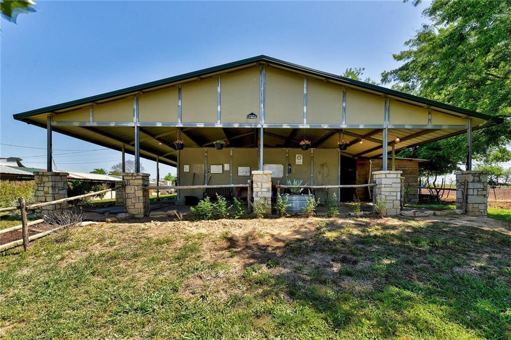 7.9 Acres of Unrestricted property just 20 minutes from Downtown Austin, and 15 minutes to Southpark Meadows! The main house, built in 1960, features 3 bedrooms, 2.5 bathrooms, and a locked club room space w/ half bath. The amenities on the property include Two barns with 22 stalls, 3 tack rooms, 2 Wash Racks, 1 Veterinary Stock, Hay storage, Feed storage, a Covered Arena, Stadium-Lit Uncovered Arena, pastures, and a wet weather creek and pond. Great opportunity to have your own boarding and training business. Come and see it today!