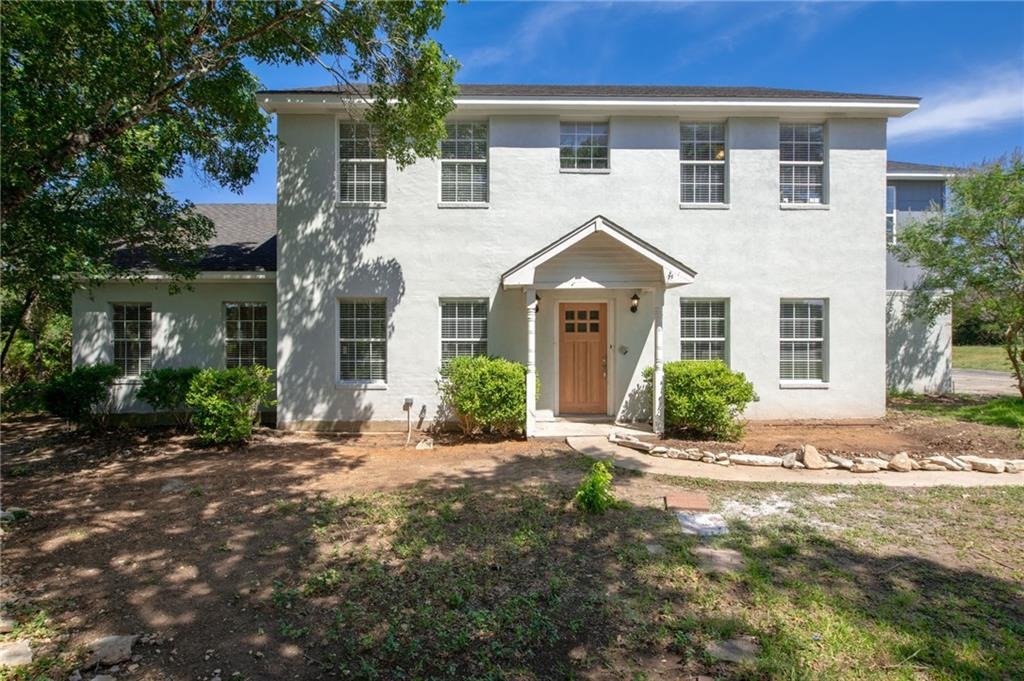 Country living close to the city & best of all....NO mandatory HOA! This 2-story stucco home is situated on a private, wooded, corner lot with mature trees nestled in the front & back of this property. Driveway is the full length of the lot & has 2 entry points; also located within the award winning LISD. Updated kitchen, master bathroom and covered patio in backyard. This home boasts room for a pool, RV, Workshop, a scenic view, Guesthouse and plenty of space for outdoor living!