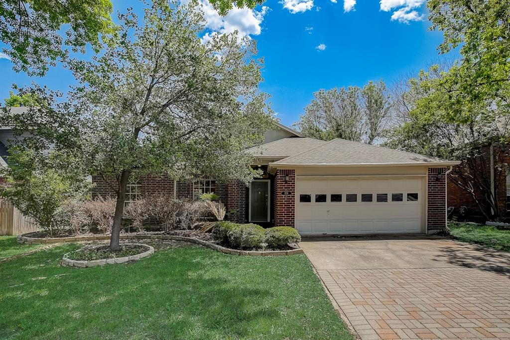 This Cedar Park two-story cul-de-sac home offers a patio, granite countertops, and a two-car garage.