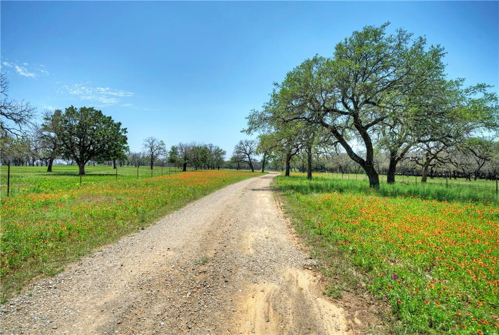 Fantastic 38+ acre ranch covered in oak trees. 35 minutes to Bee Cave. Under one hour to downtown Austin, 10 minutes to Marble Falls which offers major shopping, restaurants and entertainment as well as Horseshoe Bay Resort nearby, a world-class golf resort on the shores of Lake LBJ. 20 minutes to Lake Travis and more Highland Lakes.   The land is level and very usable cross fenced for livestock. Nice views off the back with incredible building site. Two Casitas plus barn and storage building.  Very private on county-maintained dead-end road. Excellent access off Highway 281 near Highway 71.