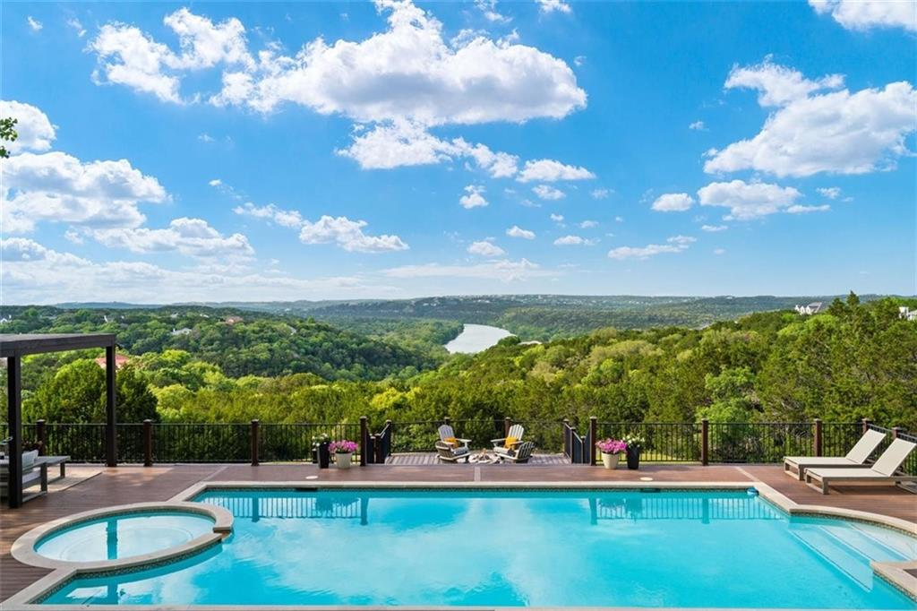 OPEN SAT AND SUNDAY.  Panoramic Lake Austin views captivate throughout the home, in gated Rob Roy on the Lake. Set back on the 2.8 acres and surrounded by mature trees creating ultimate privacy from its neighbors. High ceilings, abundant windows and natural light welcome you. The kitchen is well-equipped with Thermador appliances, double ovens, and large marble island. Flowing living, dining and bar offer space to entertain with glass doors leading you to the outdoor living. The outdoors can be enjoyed from the expansive deck, pool, spa, and fire pit. Full pool bath provides convenience. Flat grassy area allows room to play. The owner's suite is positioned to take in all the views. The marble bath is complete with a separate shower and free-standing tub. A dedicated office with built-ins completes the main level. The upper level has a large game room for entertaining with dry bar, three bedrooms, two with freshly remodeled ensuite baths, and one additional bath. Remodeling includes, wood flooring, accent walls created, and closets expanded and added. Attached garage accommodates three cars. The home is set back from the street with a circular drive allowing for additional parking. Highly acclaimed Eanes ISD with low, 1.8% tax rate.