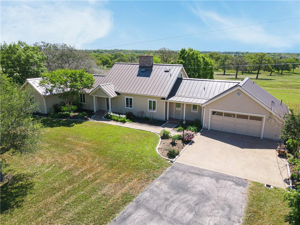 This is country living at its best that provides amazingly easy access to Austin while offering nearby benefits of historic Bastrop and major retailers.  The beautifully maintained ranch property is currently under wildlife exemption but could be reverted to farm/ranch ag use.  The home has been upgraded with standing seam roof, Hardee siding, Anderson Low-E casement windows, quartz Silestone kitchen counters, and more.  The site is conveniently located within 6 miles of HEB and Walmart, 23 miles to ABIA and 31 miles to Downtown Austin by county road and state highways.  It has a 40'x18'x 12'H RV storage port (120 mph rated) and two storage buildings.  There are more than 85 mature (mostly oak) trees on the property and along the northern property boundary on the neighboring property is a dense forest.