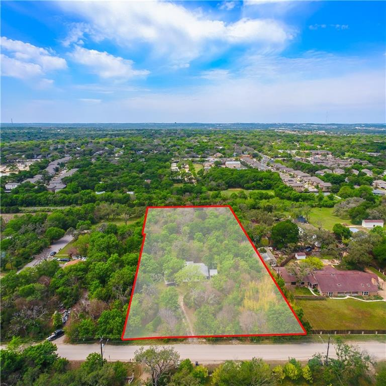 VALUE IN LAND! House is habitable  South Austin Gem of undeveloped three (3) Acres, located in South Austins highly desirable 78745 zip code, Tree Lined and uniformly flat terrain make this parcel ideal for investors, builders, or owner to design their own private oasis. Zoned DR, City of Austin Development Reserve Water Hydrant Flow Test, Tree Topography Survey, Civil Engineering Site Layout available upon request.