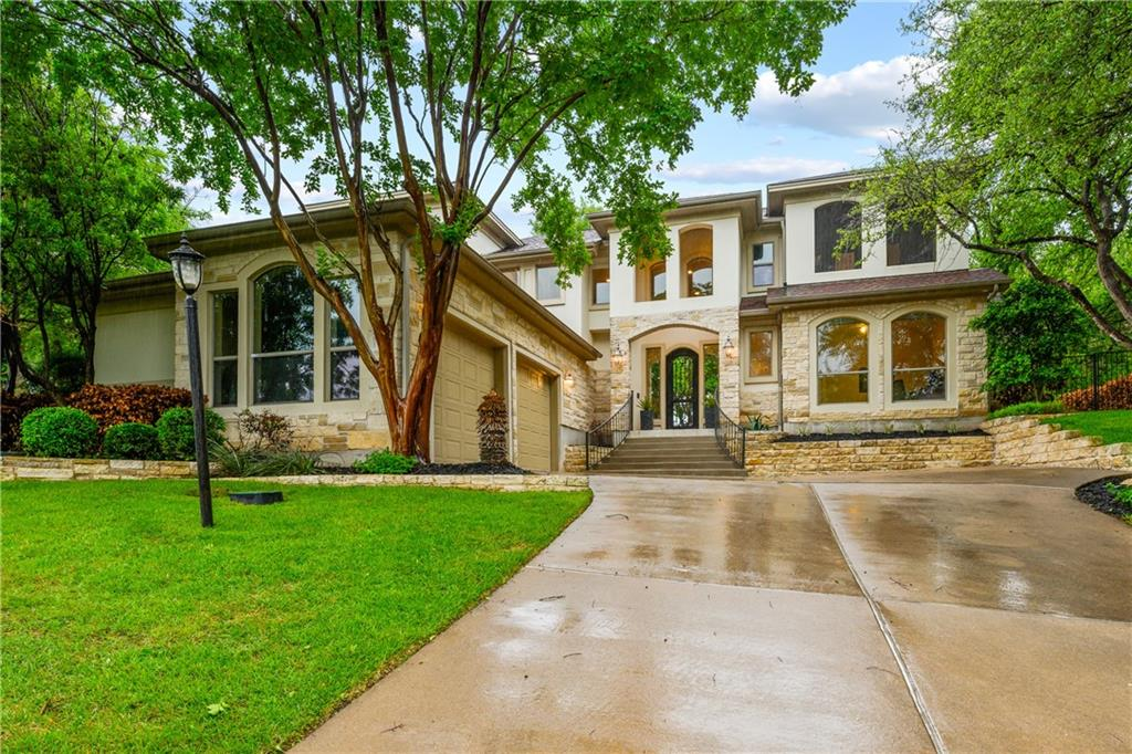 Exquisitely updated golf course home surrounded by lush landscaping and mature trees, close to Lake Travis, Hamilton Greenbelt and to the many Lakeway parks, hiking trails, and Café Lago.  Enjoy the golf course views from the quiet, well landscaped back patio, overlooking the 6th fairway of The Hills Live Oak golf course...  Or relax on one of the two upper-level patios, one screened in and the other with a newly installed retractable awning.  