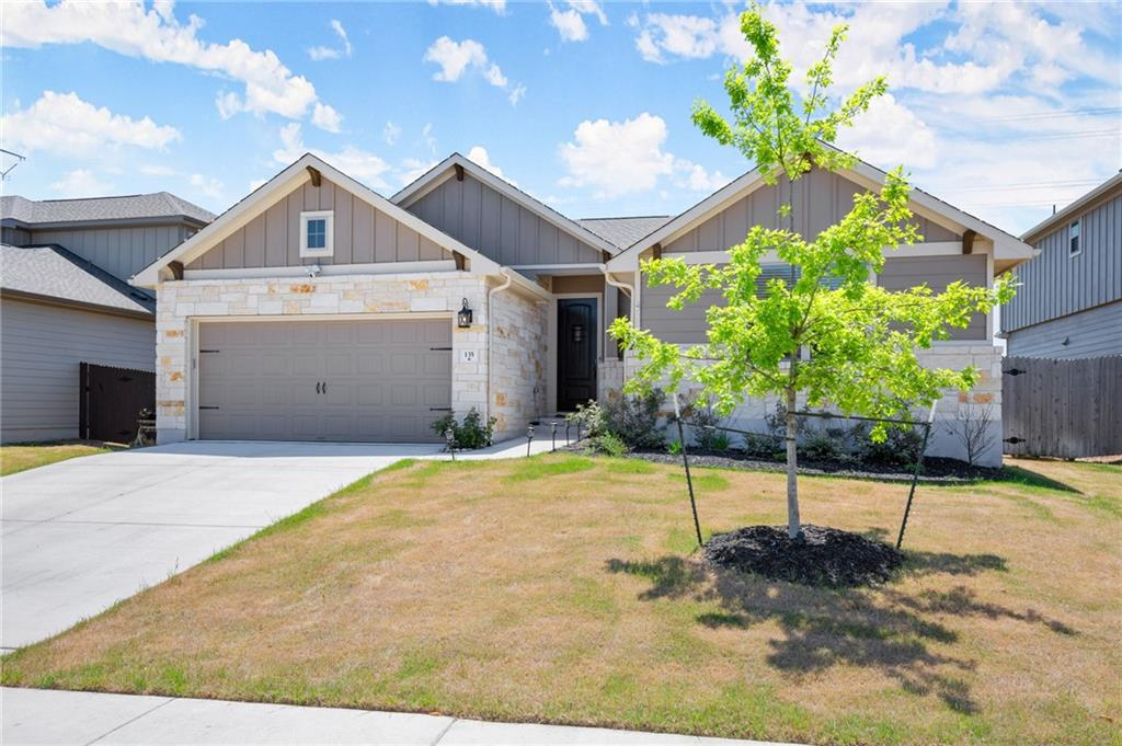 Beautiful home with incredible tile floors throughout.  Very open floorplan with high ceilings and granite countertops in the kitchen.  Upgraded security system features 4 outdoor surveillance cameras including doorbell.  A covered back patio that looks out to a large backyard completes this wonderful property.