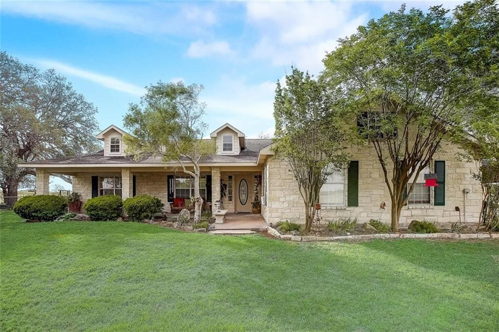 """Welcome to """"Lazy Oaks!"""" This Fayetteville 28+ acre ranch is something you need to see for yourself! This gentle rolling property has it all! The custom stone house was built in 2003, and is nestled perfectly between stately live oak trees. This house is not lacking windows bringing in the beautiful views from the outside in nearly every room. The 3 bedroom, 2 1/2 bath house is perfect for entertaining. The family room has a stone fireplace that is able to burn real wood and also has a gas hookup. The kitchen has plenty of space for guests to gather effortlessly between the dining room and the family room to the large covered porches on the front and back of the house. You will enjoy having the ample closet space and storage design in this house. There is also a bar and a built in desk nestled near the kitchen and family room. The owner's primary suite is very spacious with his and her vanities, a garden tub, shower and 2 large walk in closets. The garage has been converted to living quarters and could be used as a man-cave. There is a water well that is 725 ft. deep (per the seller). There is so much to see when it comes to the """"Lazy Oaks,"""" including a pond for fishing and a large barn with horse stalls that could be converted into a party barn. Another barn is located on the northeast side of the property with an antique truck that will convey with the sale. The property is fully fenced on all sides. The Seller's are willing to convey their surface rights and water rights.There is partial 100-year floodplain along Clear Creek. The house and barn has never flooded. Currently used as a cattle ranch. Conveniently located between Austin and Houston. Come see for yourself! Owner is a Texas licensed real estate agent."""