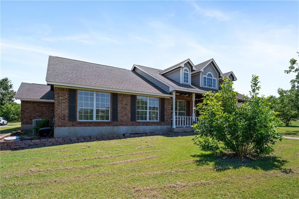Country living at it's best.  6+ acres with 2483 SF, one story home plus a shop!  And what a great location...between Hutto, Georgetown and Taylor.  And easy access to toll roads.  Open living concept with breakfast area and formal dining room.  Propane cooktop, electric oven and granite countertops in the kitchen.  HUGE center island for gathering and entertaining.  Living area boasts a wood burning stove and lots of room!  Master bath recently remodeled with wood like tile flooring, big walk in shower, double vanities, large walk in closets!!  The home has four bedrooms, PLUS an office!