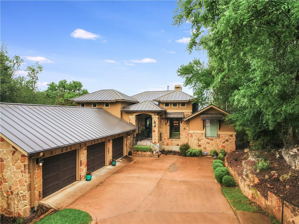 Beautifully appointed Laurel Haven Custom Home with a tremendous amount of upgrades. Once you enter through the front door of this home with its luxurious Cantera Doors you can see the serene setting immediately like none other. With a greenbelt on one side and large trees on the other it makes for a very private setting. The large covered patio with a fireplace overlooks the pond and the Par 3, 13th hole of the Yaupon Golf Course. Large island kitchen open to the family room. Formal dining with a bar area and huge window looks out to the greenbelt. Downstairs is an additional living and kitchenette. Living opens to another large patio. Three full beds, 2 baths and study all down. Laundry room with pantry & dumb waiter that can hold up to approx 100 lbs. Perfect for sending laundry, food and even cocktails up and down for your guests.  It is truly like a whole separate home down. Easy access to Lakeway Blvd and Lohmans Crossing. you do not want to miss this one.