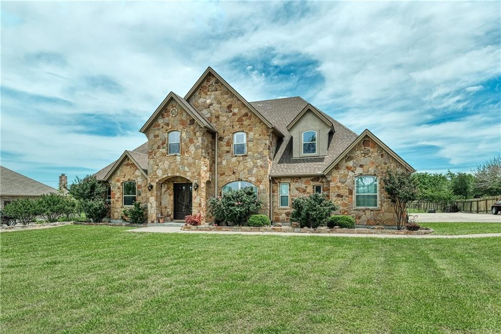 Get the MOST FOR YOUR MONEY in this CUSTOM HOME only 30 mi (or less) to downtown AUSTIN, Tesla, Apple, Dell, Samsung, Domain & the airport!  This SPACIOUS floorplan offers 4611 sq feet on 1.08 ac. The sought-after neighborhood, LOOKOUT AT BRUSHY CREEK.  Quiet, country living & LOW TAXES, but close to city conveniences.   Step into this SPACIOUS home with natural light, custom rock work & peaceful backyard overlooking uninhabited land. The living room is open to the kitchen, which has a large breakfast bar & island, granite counters, STONE ACCENT WALLS, stainless steel monogram appliances, & double ovens. The PRIMARY SUITE & A MOTHER-IN-LAW SUITE are located on the main floor, as well as an office & laundry.  The 2nd floor, has a palatial game room, wet bar & 2nd STORY BALCONY. 3 more bedrooms, media room, 2 full baths & loft.  3 CAR GARAGE, gutters, sprinkler system & recently replaced HVAC units.  Grab your golf cart & fish in the gated community lake.