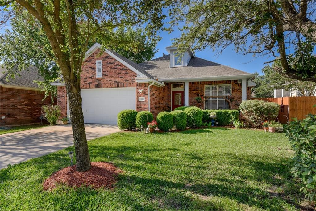 """With 3 bedrooms and 2 bathrooms, plus an office and a """"guest retreat"""" bonus space, there's room for everyone in this 2302-square-foot brick beauty set in Round Rock's friendly Mayfield Ranch neighborhood. You'll love the home's welcoming front porch with its charming columns — imagine greeting neighbors, sweet tea in hand! Inside, note the gorgeous wood-look tile flooring in the large living room, and appreciate the extra-special touches such as crown molding, plantation shutters and arched pass-throughs in this open-floor-plan, one-story home. You'll love cozy nights around the fireplace, with its tile surround and the generous mantlepiece for displaying family treasures. There's a formal dining room for special occasions, as well as a breakfast room for more casual meals. The kitchen provides plenty of storage, acres of gorgeous granite countertops and a bi-level island with plenty of room for seating. Away from bedrooms and living areas, the office is quiet and perfect for working from home. When the day is done, retreat to your primary suite, featuring a large bedroom and ensuite bathroom with double vanity, separate shower and tub, and big walk-in closet. The two secondary bedrooms share a full bathroom and a bonus space that would make a perfect playroom or private lounging area. Outside, appreciate the covered porch and spacious flagstone patio – perfect for entertaining. The fenced-in yard has beautiful, mature trees, lovely landscaping, and a playscape. You'll love the neighborhood amenities: clubhouse, swim center and playground. Further afield, you'll be a short drive from Southwest Williamson County Regional Park, where you'll find the Quarry Splash Pad, basketball courts, baseball fields, group pavilions and a miniature train. Plenty of shopping and restaurants nearby, and easy access to I-35 and Highway 183. Round Rock ISD schools include the exemplary-rated Chandler Oaks Elementary and Walsh Middle Schools."""