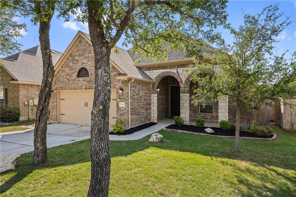 Welcome to this inviting, three-bedroom, two-bath home located in the Crystal Falls neighborhood in Leander. Walk-in and be greeted with a hallway leading to the living area and a bonus room with french glass doors that is perfect for an office or playroom. The open floor plan living area has luxury vinyl plank flooring, recessed lighting, and multiple windows that allow ample natural light. The chef kitchen features granite countertops, dark natural wood cabinetry, tile backsplash, lots of storage space, stainless steel appliances, pantry, kitchen island, and bar top seating. A quaint dining nook is adjacent to the kitchen and is perfect for meals with the family! The large Master Bedroom has carpet, multiple windows, and an attached bath with a step-in shower, a vanity, and his+her walk-in closets. The other two bedrooms are spacious and have carpet floors and ceiling fans! Upstairs you will find a spacious family media room perfect for watching sporting events or gaming. The backyard has an extended, covered patio and plenty of room for pets and kids to play. Great location only 5 minutes from Gann Ranch Park and a short drive 1890 Ranch Shopping Center.